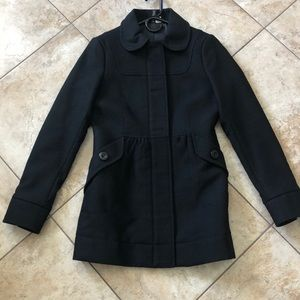 H&M black coat with button detail.